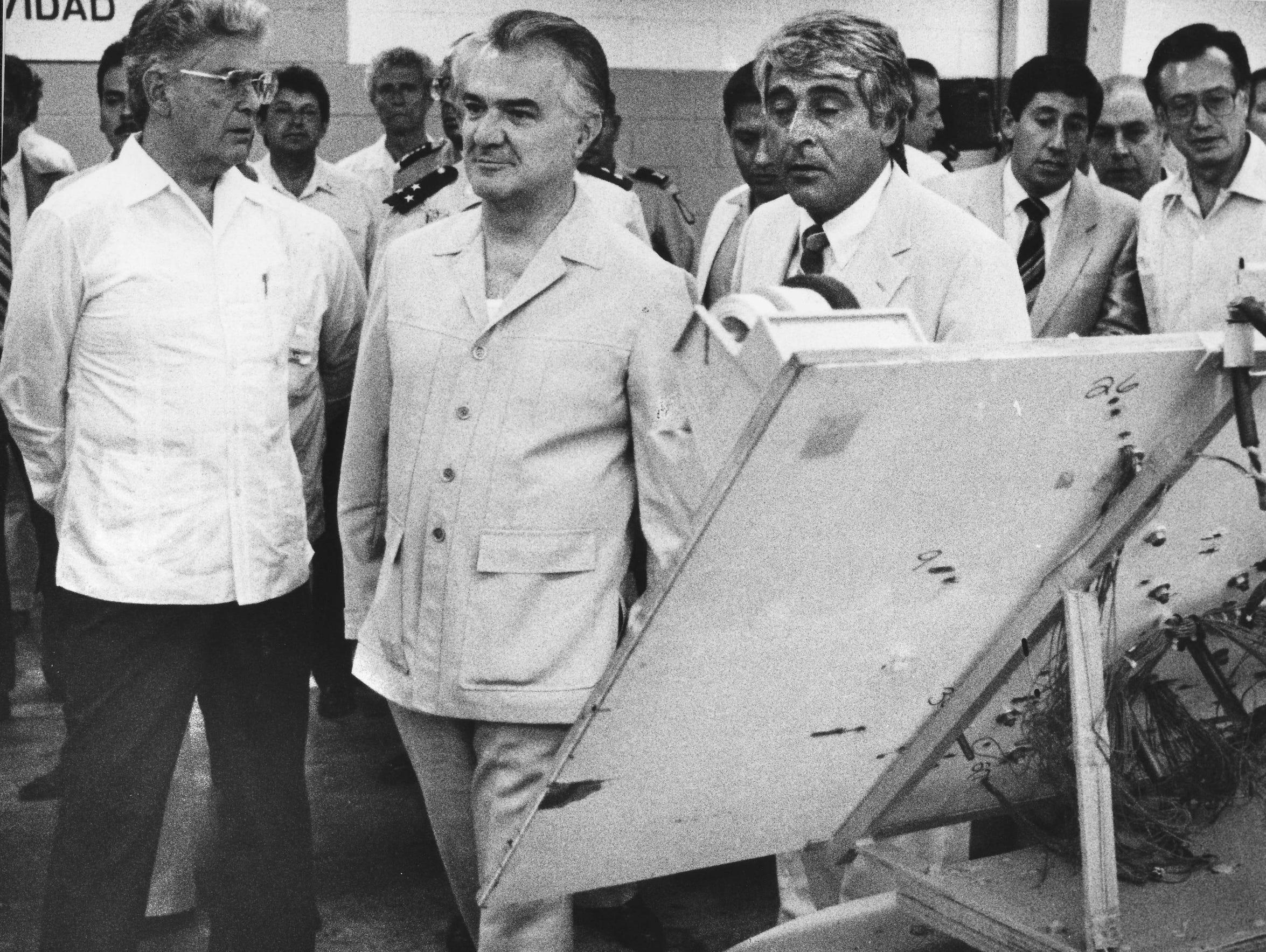 Miguel De La Madrid visits a maquiladora factory in 1987.