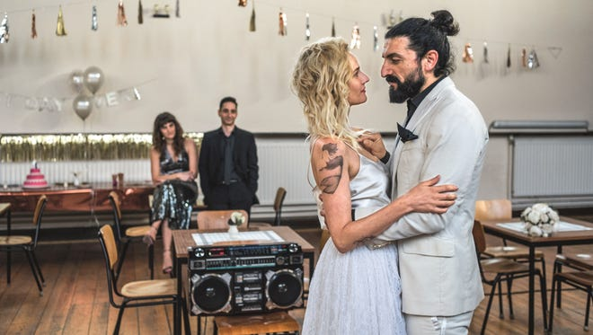 """Nuri (Numan Acar) and Katja (Diane Kruger) marry in prison in """"In the Fade."""""""