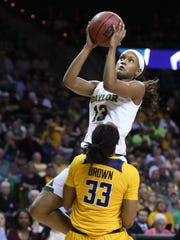 Baylor forward Nina Davis drives into California forward Jaelyn Brown during the second half of a second-round game in the NCAA women's college basketball tournament in Waco, Texas, Monday, March 20, 2017. Baylor won 86-46. (AP Photo/Rod Aydelotte)