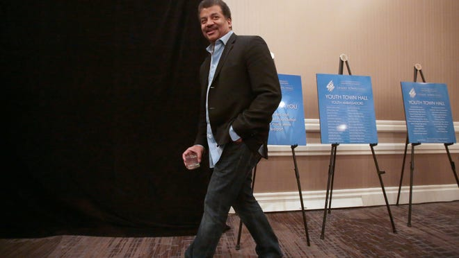Astrophysicist Neil deGrasse Tyson takes to the podium to speak to high school students at the Youth Town Hall before speaking at the H.N. and Frances C. Berger Foundation Presents Desert Town Hall on Thursday at the Renaissance Esmerelda Resort in Indian Wells.