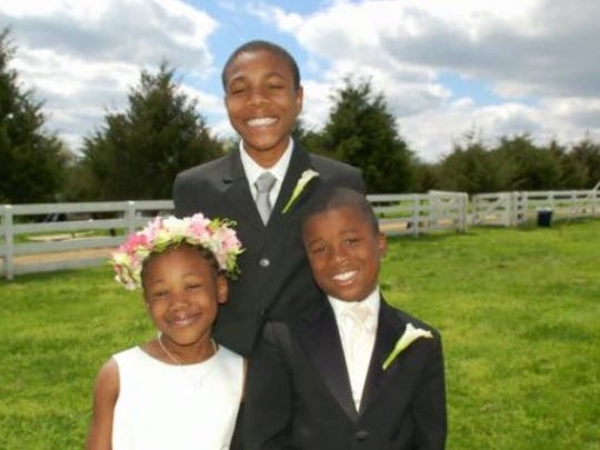 Treyonta Burleson as a child with her brothers