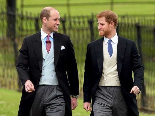 Prince William and Prince Harry at a wedding in May