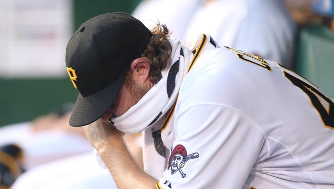 Aug 17, 2015: Pittsburgh Pirates starting pitcher Gerrit Cole (45) reacts in the dugout after pitching against the Arizona Diamondbacks in the first inning at PNC Park.