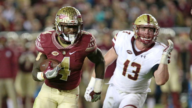 Florida State's Dalvin Cook gets past Boston College's Connor Strachan on his way to a touchdown Nov. 11, 2016, in Tallahassee, Fla.