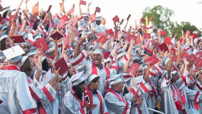 Members of Vineland High School's Class of 2017 celebrate at the conclusion of Vineland High School's graduation ceremony on Wednesday, June 14, 2017.