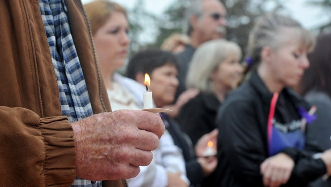 A crowd of over 100 people showed up in support for victims of domestic violence during a candlelight vigil that was held at the Veterans Memorial near the Ventura County Government Center in June 2016. STAR FILE PHOTO