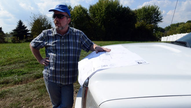 John Watson, executive director of Habitat for Humanity of Fairfield County, stands on an empty lot where the agency plans to build multi-unit family housing for veterans on the south side of Lancaster.