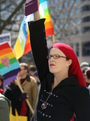 Brittney East Smith of Indianapolis took video on the steps of the Indiana Statehouse in Indianapolis on March 28, 2015, when several thousand people gathered to oppose Indiana's recently passed Religious Freedom Restoration Act.