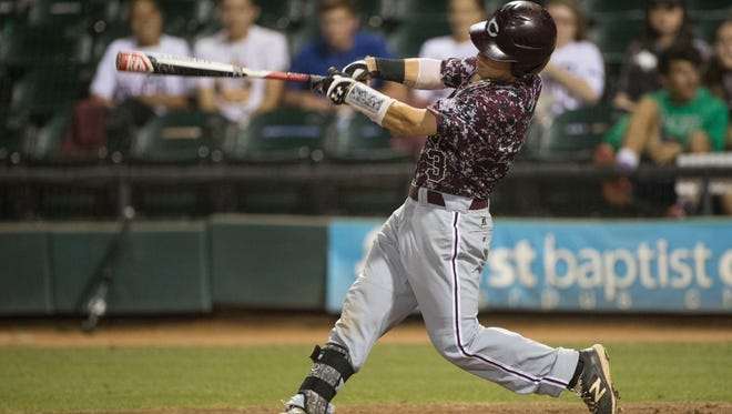 Calallen's Brandon Broughton hits a single during the third inning of the second game against Ray of a 5A regional quarterfinal baseball series at Whataburger Field on Friday, May 19, 2017.