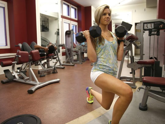 Sarah Grace Spann, who runs freshfitnhealthy.com a blog with healthy recipes and reviews of fitness related technology, demonstrates some of her personal fitness routine at her apartment complex on Sunday, Nov. 1, 2015.
