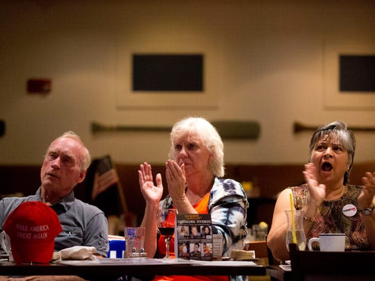 Naples residents Larry McManus, from left, Sharon McManus, and Beverly Wood cheer on Republican presidential candidate Donald Trump while watching the first presidential debate at ROW Seafood by Capt. Brien and Crew restaurant Monday, September 26, 2016 in Naples.