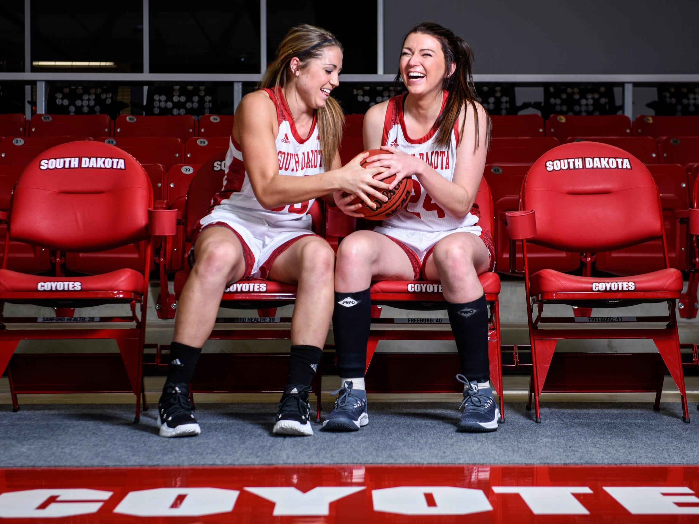 Caitlin Duffy (left) and her sister Ciara (right) pose
