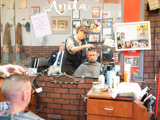 Chris Buckley gets a haircut from Shear Time owner Anita Griffin at her shop in LaFayette, Georgia.