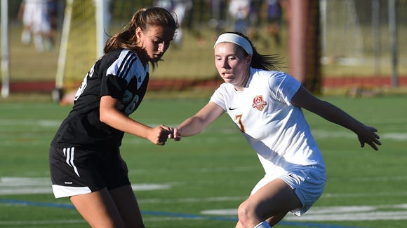 Arlington's Kaylee Sturans, right, goes for the ball while Rye's Sara DeGraw, left, defends during Wednesday's game.