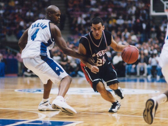 Former CBA standout Geoff Billett drives to the basket for Rutgers in a 1996 game against Seton Hall.