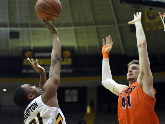 Southern Miss' Anfernee Hampton shoots over a defender