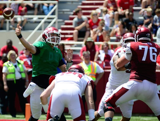 Arkansas quarterback Brandon Allen, left, delivers a pass during the spring game.