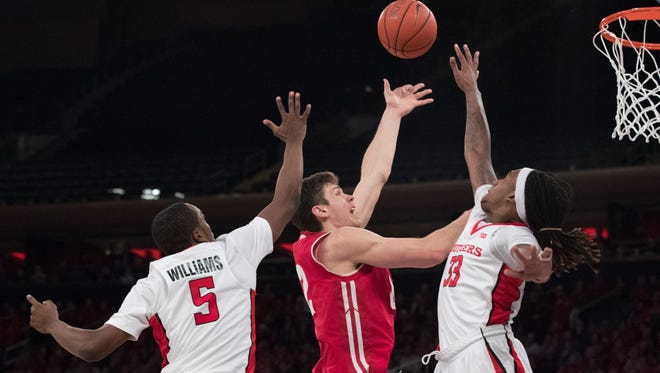 Wisconsin forward Ethan Happ goes to the basket past Rutgers guard Mike Williams (5) and forward Deshawn Freeman.