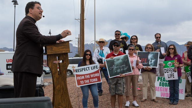 Bishop Oscar Cantu of the Diocese of Las Cruces addresses participants in the 40 Days for Life March held Saturday afternoon.