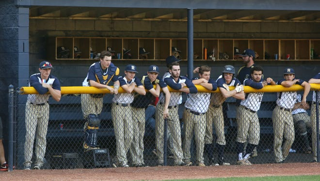 Roberson's dugout looks on during Tuesday night's 8-1 home win over Mallard Creek.