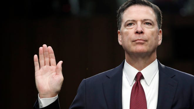 Former FBI director James Comey is sworn in during a Senate Intelligence Committee hearing on June 8, 2017.