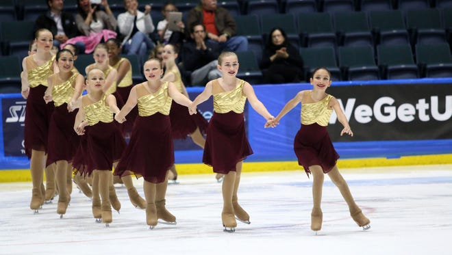 Everblades in Synk, the synchronized figure skating team, derived from the Florida Everblades Figure Skating Club, competes in the open juvenile division of the 2018 Eastern Synchronized Sectional Championships at Germain Arena on Wednesday.