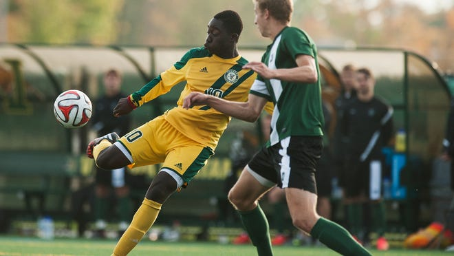 Vermont's Bernard Yeboah (10) kicks the ball during the men's soccer game between the Dartmouth Big Green and the Vermont Catamounts at Virtue Field on Wednesday afternoon October 1, 2014 in Burlington, Vermont.
