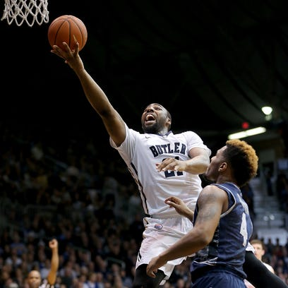 Butler's Kellen Dunham drives past Marquette's Luke Fischer during the Bulldogs' 73-52 win over over the Golden Eagles at Hinkle Fieldhouse on Feb. 25, 2015. Dunham led Butler with 22 points.