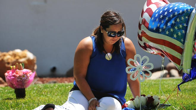 Ashley Deane visits the gravesite of her sons Jacob and Austin at Our Mother of Sorrows Catholic Cemetery on July 2, 2015. Deane's children were tragically killed by her husband, who then killed himself. Deane brought patriotic flowers and balloons for her son Jacob's birthday, who was born on July 4th. Jason Bean/RGJ