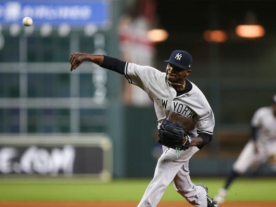 Yankees relief pitcher Domingo German delivers a pitch