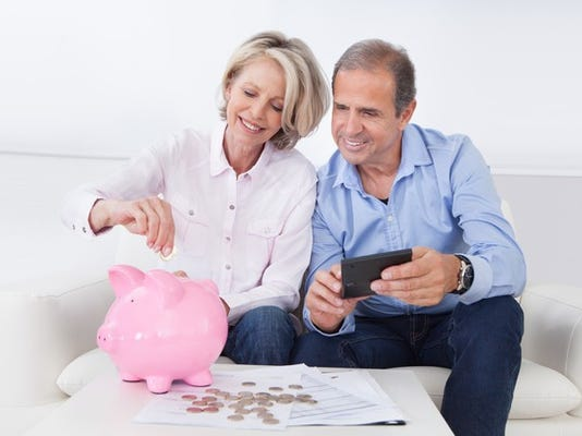 retirement-savings-couple-piggy-bank_large.jpg