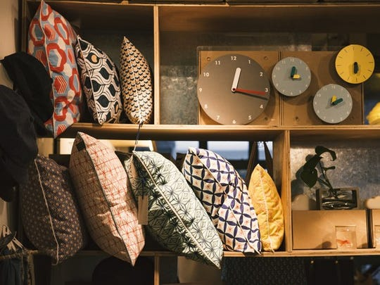 Home decor shop with pillows and clocks