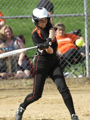 Lucas' Gabby Smith hits the ball during a home game against Norwalk St. Paul on Thursday.