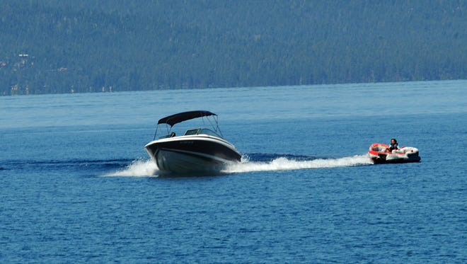 A high speed boat pulls a woman on a flotation device on Lake Tahoe near Cave Rock Tuesday July 11, 2011. Marilyn Newton/RGJ