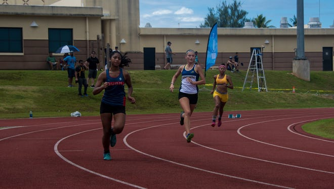 Elizabeth Quintanilla, Emma Sheedy and Tori Starr during the women's 400m run  at the GFTA's National Championships open meet in June.