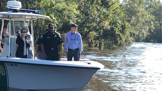 Gov. Rick Scott toured Clay County homes along Black Creek that were damaged by a flash flood caused by Hurricane Irma.