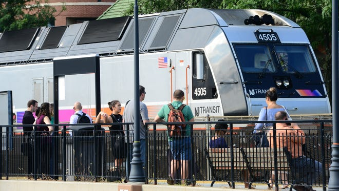 A disabled NJ Transit Train sits empty on the tracks at the Rutehrford Train Station Friday morning. Passengers were asked to wait for another Hoboken bound train on the other side of the tracks.