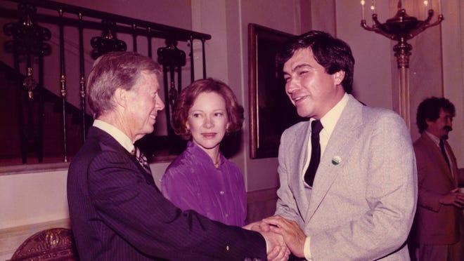 Jimmy and Rosalyn Carter meet with Joe Eddie Lopez of Chicanos Por La Causa.