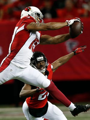 Atlanta Falcons free safety Dwight Lowery defends Arizona Cardinals receiver Michael Floyd (15) as Floyd makes a catch during a game on Sunday, Nov. 30, 2014, in Atlanta.