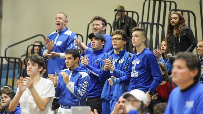 Williamstown's wrestlers cheer on a teammate during a bout on Saturday against Clayton. The Braves endured a tough week that included two team members who underwent emergency surgeries.