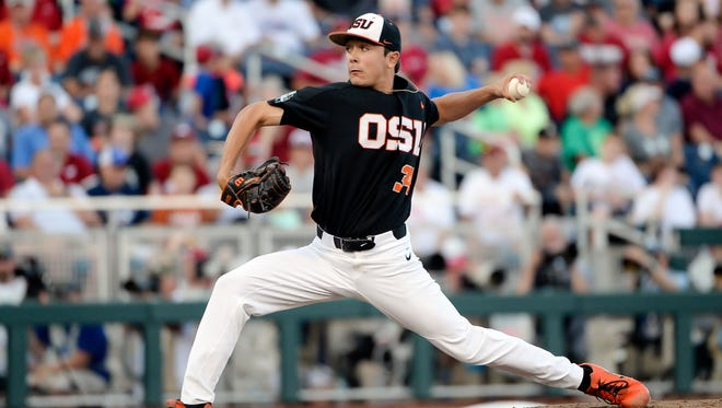 Oregon State pitcher Christian Chamberlain pitches in the fifth inning against Arkansas in game one of the championship series of the College World Series at TD Ameritrade Park.