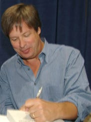 Humorist Dave Barry signs an autograph in this 2012