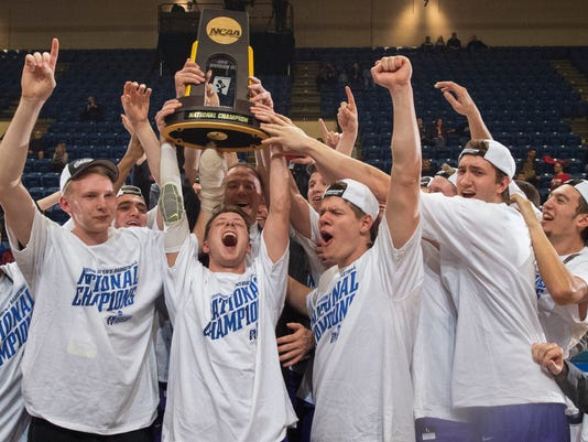 St. Thomas of Minnesota players, from left, Thomas Sjoberg, Grant Shaeffer, Will Dunn, Jodan Burich and G.T. Johnson celebrate after St. Thomas won NCAA Division III men's college basketball championship game 82-76 over Benedictine of Illinois on Saturday, March 19, 2016, in Salem, Va. (AP Photo/Don Petersen)