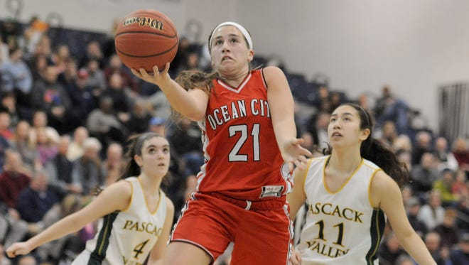 Ocean City's Grace Sacco drives for a layupl against Pascack Valley during Sunday's Group 3 final at Pine Belt Arena.