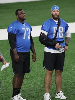 Detroit Lions linemen Greg Robinson, left, and Taylor Decker watch drills during minicamp Thursday, June 15, 2017 at the practice facility in Allen Park.