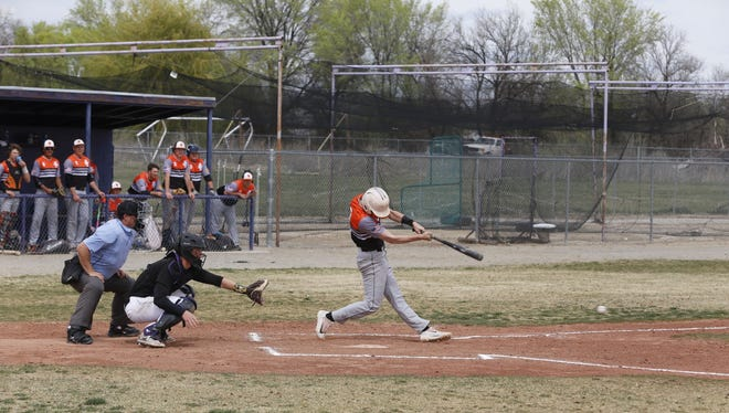 Aztec's Zach Taylor hits an RBI single against Kirtland Central on Saturday in Kirtland.