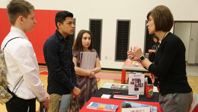 Elgin students Ry Chviek,  Isaac Salinas and Kaitlyn Burton, meet with Laurie Patton from Ohio Wesleyan University during the college fair at Elgin's College and Career Readiness Day.