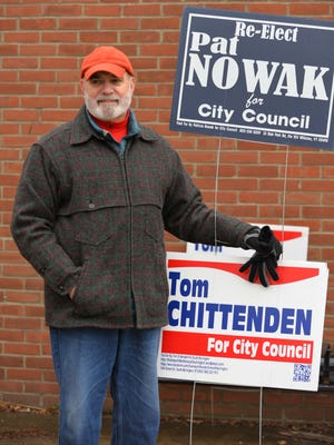 Ken Boyd stands outside of Orchard School in South Burlington on Town Meeting Day, March 7, 2017, with signs for incumbent City Council candidates Pat Nowak and Thomas Chittenden.