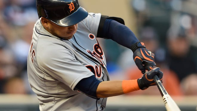 Tigers shortstop Jose Iglesias hits a solo home run in the first inning of Monday's win in Minneapolis.