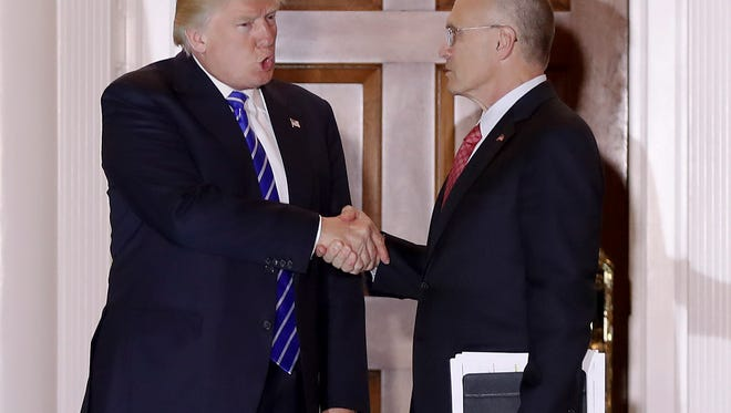 President-elect Donald Trump and Andy Puzder, chief executive of CKE Restaurants, shake hands last month as Puzder leaves Trump National Golf Club Bedminster clubhouse in Bedminster, N.J. Trump has tapped Puzder as his pick to head the Labor Department. Trump's election as president has made many small business owners more upbeat about 2017. Many owners are more confident because their revenue looks to increase in 2017 due to the overall improving economy. They're also optimistic because they expect Trump to deliver on promises to lower taxes and roll back regulations including parts of the health care law. (AP Photo/Carolyn Kaster, File) ORG XMIT: NYBZ311